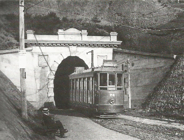 a tram coming out of the tunnel